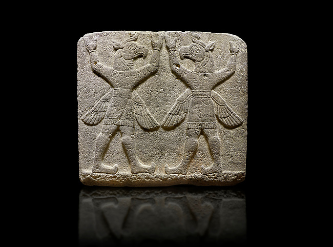 "Photo of Hittite relief sculpted orthostat stone panel of Herald's Wall Basalt, Karkamıs, (Kargamıs), Carchemish (Karkemish), 900-700 B.C. Bird-headed, winged figures of human body. Anatolian Civilisations Museum, Ankara, Turkey.<br /> <br /> These figures are called as ""Winged Griffin Demons"". Embossing is constructed symmetrically. Their hands are on their heads. It is assumed that they carry the heavens. <br /> <br /> Against a black background."