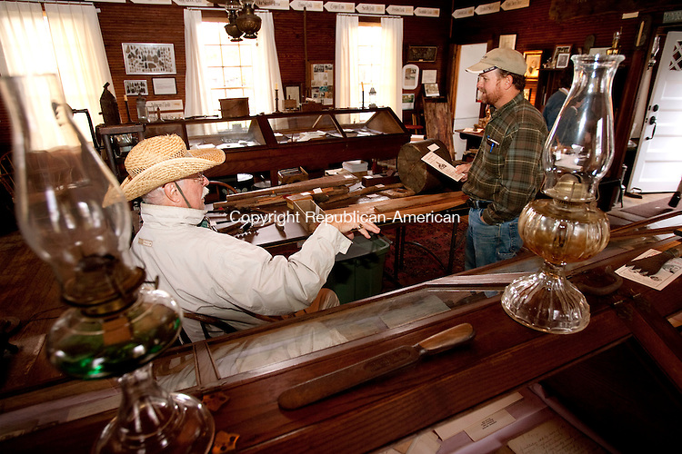 WINSTED, CT, 16 OCTOBER 2010-101610JS02-Dale Parsons-Marchinoe, left, interim president of the Winchester Center Historical Association talks with Matthew Hunter, right, after he stopped by to look at the exhibits inside the Historical Association Museum on Saturday during Winchester Center Day. The The Winchester Grange, Winchester Center Congregational Church, Winchester Center Historical Association and Winchester Center Volunteer Fire Department all took part in the event. <br />  Jim Shannon Republican-American