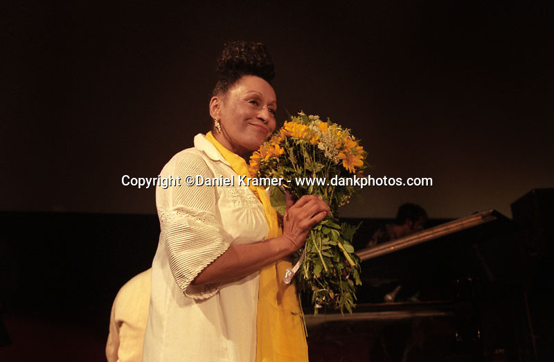 Omara Portuondo receives flowers from a fan prior to performing live on stage with the Buena Vista Social Club musical collective in Havana after the 1999 Cuban premiere of the Buena Vista Social Club film by German directer Wim Wenders.