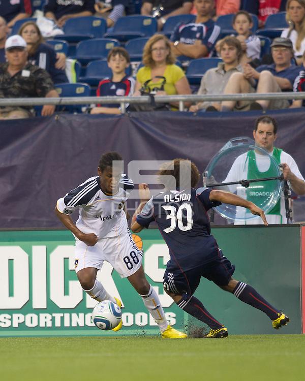 Los Angeles Galaxy defender Alex Cazumba (88) takes on New England Revolution defender Kevin Alston (30). The New England Revolution defeated LA Galaxy, 2-0, at Gillette Stadium on July 10, 2010.