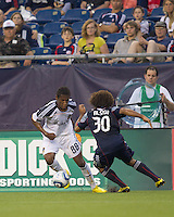 Los Angeles Galaxy defender Alex Cazumba (88) takes on New England Revolution defender Kevin Alston (30). The New England Revolution defeated LA Galaxy, 2-0, at Gillette Stadium on July 10, 2010.