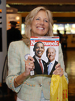 Jill Biden, wife of Sen. Joe Biden, the vice presidential half of the soon-to-be-official Democratic ticket, holds up a news magazine to show her husband when they made a surprise appearance Monday Aug. 25, 2008 at the Amtrak train station in Wilmington, Del. (AP Photo/Bradley C Bower)