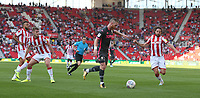Leeds United's Adam Forshaw prepares to shoot as Stoke City's Joe Allen closes in<br /> <br /> Photographer Stephen White/CameraSport<br /> <br /> The Premier League - Stoke City v Leeds United - Saturday August 24th 2019 - bet365 Stadium - Stoke-on-Trent<br /> <br /> World Copyright © 2019 CameraSport. All rights reserved. 43 Linden Ave. Countesthorpe. Leicester. England. LE8 5PG - Tel: +44 (0) 116 277 4147 - admin@camerasport.com - www.camerasport.com