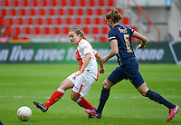 20150508 - LIEGE , BELGIUM : Standard's Kim Mourmans (left) pictured in action during the soccer match between the women teams of Standard de Liege Femina and PSV Eindhoven , on the 26th and last matchday of the BeNeleague competition Friday 8 th May 2015 in Stade Maurice Dufrasne in Liege . PHOTO DAVID CATRY