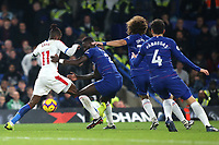 Three Chelsea players get ready to tackle Wilfried Zaha of Crystal Palace during Chelsea vs Crystal Palace, Premier League Football at Stamford Bridge on 4th November 2018