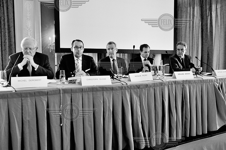 A panel of male speakers at the annual press conference of the Swiss Private Bankers Association, held in the luxury Bellevue Palace Hotel. /Felix Features
