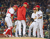Washington Nationals pitching coach Mike Maddux (51), left center, visits the mound to settle down starting pitcher Gio Gonzalez (47), right, after he gave-up a fifth inning home run to New York Mets center fielder Yoenis Cespedes (52) in the fifth inning at Nationals Park in Washington, D.C. on Monday, May 23, 2016.  Also in the meeting are Washington Nationals catcher Wilson Ramos (40), left, and shortstop Danny Espinosa (8), right center.  The Mets won the game 7 - 1.<br /> Credit: Ron Sachs / CNP