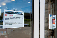 A notice is posted on the glass door of the Washington Monument gift shop, to inform people that the monument is closed as the United States deals with the COVID-19 pandemic in Washington, DC, Tuesday, March 17, 2020. Credit: Rod Lamkey / CNP/AdMedia