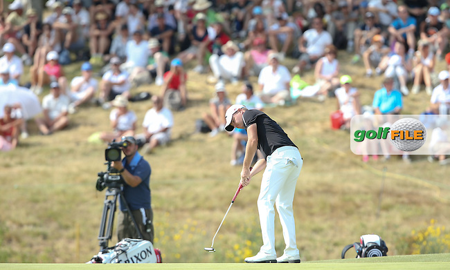 James Morrison (ENG) putts out on the last during Round Three of the 2015 Alstom Open de France, played at Le Golf National, Saint-Quentin-En-Yvelines, Paris, France. /04/07/2015/. Picture: Golffile | David Lloyd<br /> <br /> All photos usage must carry mandatory copyright credit (&copy; Golffile | David Lloyd)