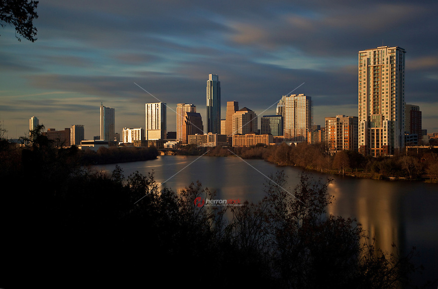 Late afternoon sun warms the new Austin Cityscape from Travis Heights View.