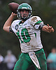 Tommy Donovan #10, Farmingdale quarterback, completes a pass for a first down during the fourth quarter of a Nassau County Conference I varsity football game against host Massapequa High School on Saturday, Oct. 8, 2016. Farmingdale won by a score of 45-42.