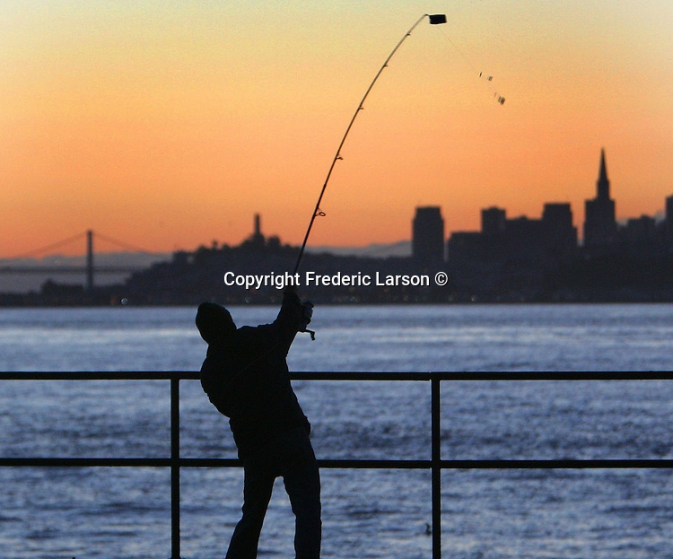 The fisherman back to business along Fort Baker Pier and making a hull catching crab catch in the beginning of crab season in San Francisco.