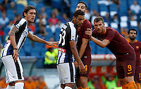 Calcio, Serie A: Roma vs Udinese. Roma, stadio Olimpico, 20 agosto 2016.<br /> Roma&rsquo;s Kostas Manolas, second from right, and Roma&rsquo;s Edin Dzeko, right, face Udinese&rsquo;s Gabriele Angella, left, and Kadhim Ali Adnan, during the Italian Serie A football match between Roma and Udinese at Rome's Olympic Stadium, 20 August 2016. Roma won 4-0.<br /> UPDATE IMAGES PRESS/Riccardo De Luca