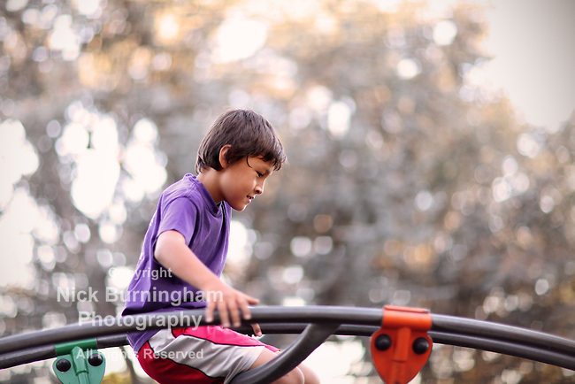 Young boy playing in a park - EXCLUSIVELY AVAILABLE HERE