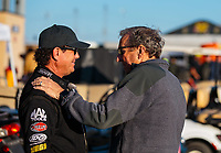 Jun 1, 2018; Joliet, IL, USA; NHRA top fuel driver Billy Torrence (left) talks with team owner Don Schumacher during qualifying for the Route 66 Nationals at Route 66 Raceway. Mandatory Credit: Mark J. Rebilas-USA TODAY Sports