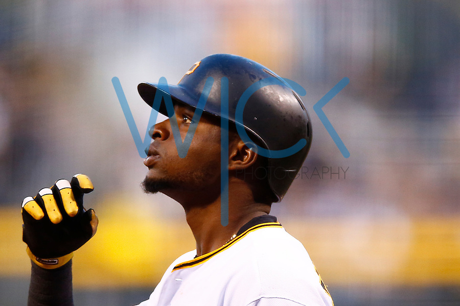 Gregory Polanco #25 of the Pittsburgh Pirates reacts at home plate against the New York Mets during the game at PNC Park in Pittsburgh, Pennsylvania on June 8, 2016. (Photo by Jared Wickerham / DKPS)