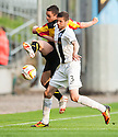 Partick's Steven Lawless and Ayr Utd's Gordon Pope challenge for the ball.