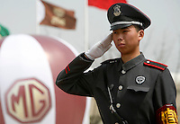 Chinese guards stands near a balloon displaying a MG logo at the launching ceremony of the first Chinese built MG vehicles in Nanjing, China. The Chinese company is now in a position to take on Rover's assets and plan its future. It intended to relocate the engine plant and some car production plant to China but to retain some car production plant in the UK..27 Mar 2007