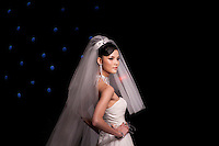 Famous chinese model Mo Wandan is presenting a wedding dress created by the Hong Kong stylist Dorian Ho, at the China Fashion Week Automn/winter 2011. Beijing, March 28 2010.