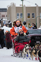 Meredith Mapes and team leave the ceremonial start line with an Iditarider and handler at 4th Avenue and D street in downtown Anchorage, Alaska on Saturday March 3rd during the 2018 Iditarod race. Photo ©2018 by Brendan Smith/SchultzPhoto.com