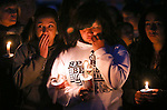 Hundreds of students and residents attended a candlelight vigil at Sparks Middle School in Sparks, Nev., on Wednesday, Oct. 23, 2013, in honor of slain teacher Michael Landsberry and two 12-year-old students who were injured after a fellow student open fire at the school on Monday, before turning the gun on himself.  (AP Photo/Cathleen Allison)