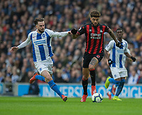 Huddersfield Town's Philip Billing (right) holds off the challenge from Brighton & Hove Albion's Davy Propper (left) <br /> <br /> Photographer David Horton/CameraSport<br /> <br /> The Premier League - Brighton and Hove Albion v Huddersfield Town - Saturday 2nd March 2019 - The Amex Stadium - Brighton<br /> <br /> World Copyright © 2019 CameraSport. All rights reserved. 43 Linden Ave. Countesthorpe. Leicester. England. LE8 5PG - Tel: +44 (0) 116 277 4147 - admin@camerasport.com - www.camerasport.com