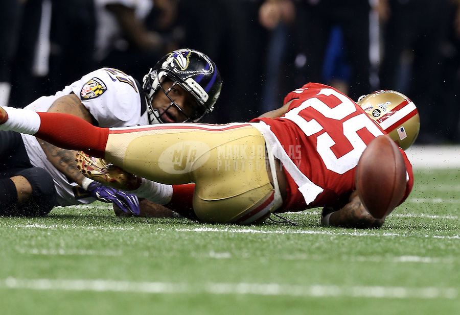 Feb 3, 2013; New Orleans, LA, USA; Baltimore Ravens running back Ray Rice (left) fumbles the ball after being tackled by San Francisco 49ers cornerback Tarell Brown in the third quarter in Super Bowl XLVII at the Mercedes-Benz Superdome. Mandatory Credit: Mark J. Rebilas-