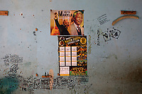 A picture of Nelson Mandela and graffiti adorn a wall in a so-called 'hijacked building' on Bree Street soon after the Red Ants evicted the occupants.The Red Ants are a controversial private security company often hired to clear squatters from land and so-called 'hijacked' properties.
