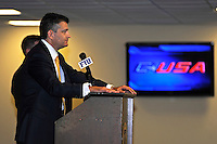 4 May 2012:  FIU Executive Director of Sports and Entertainment Pete Garcia (at podium) speaks at a press conference during which the FIU Golden Panthers, currently a member of the Sun Belt Conference, formally announced their acceptance of an invitation to join Conference USA for all sports starting July 1, 2013, at the FIU Stadium Club in Miami, Florida.