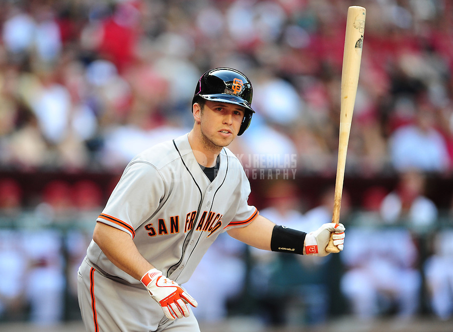 Apr. 6, 2012; Phoenix, AZ, USA; San Francisco Giants catcher Buster Posey tosses his bat after being walked in the first inning against the Arizona Diamondbacks during opening day at Chase Field.  Mandatory Credit: Mark J. Rebilas-