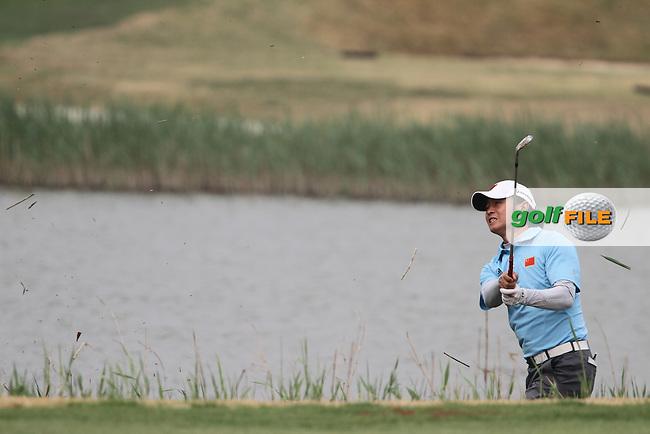 Huang Wen-Yi (CHN) on the 18th on Day 1 of the 2012 Volvo China Open at Binhai Lake Golf Club, Tianjin, China...(Photo Jenny Matthews/www.golffile.ie)