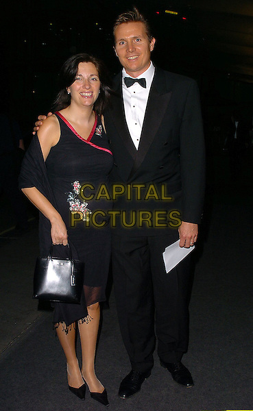 ROGER BLACK & GUEST.The 22nd Annual Sport Ball at the Hilton,.London, 14th September 2005.full length black tuxedo dress pink trim.Ref: CAN.www.capitalpictures.com.sales@capitalpictures.com.©Capital Pictures