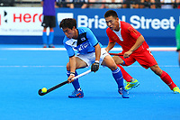 Korea's Kim Ki Hoon shields the ball from Su Lixing of China during the Hockey World League Semi-Final Pool A match between China and Korea at the Olympic Park, London, England on 17 June 2017. Photo by Steve McCarthy.