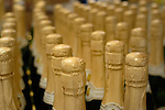 Rows of bottles of Champagne await your pleasure.