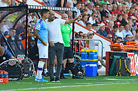 Manchester City Manager Pep Guardiola attempts to bring n Joao Cancelo of Manchester City during AFC Bournemouth vs Manchester City, Premier League Football at the Vitality Stadium on 25th August 2019