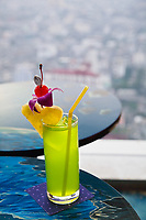 Traditional Thai drink on table in restaurant high above Bangkok, Thailand