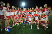 The Swans pose for a team photo after winning the Australian Rules Football ANZAC Day match between St Kilda Saints and Sydney Swans at Westpac Stadium, Wellington, New Zealand on Thursday, 24 May 2013. Photo: Dave Lintott / lintottphoto.co.nz