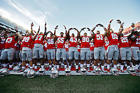 Ohio State Buckeyes players sing Carmen Ohio following their 38-0 win over Hawaii in the NCAA football game at Ohio Stadium in Columbus on Sept. 12, 2015. (Adam Cairns / The Columbus Dispatch)