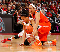 Ohio State's Martina Ellerbe (23) collides with Illinois Sarah Livingston (4)  in the first half of their game against the Illinois Fighting Illini at the Value City Arena in Columbus, Ohio on January 30, 2014. (Columbus Dispatch photo by Brooke LaValley)