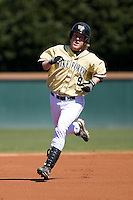 Willy Fox (9) of the Wake Forest Demon Deacons rounds the bases following his solo home run in the bottom of the first inning versus the Clemson Tigers during the second game of a double header at Gene Hooks Stadium in Winston-Salem, NC, Sunday, March 9, 2008.