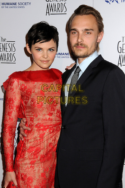 GINNIFER GOODWIN & JOEY KERN .24th Annual Genesis Awards - Arrivals held at the Beverly Hilton Hotel, Beverly Hills, California, USA, 20th March 2010..half length couple red lace dress long sleeved sleeves clutch bag blue shirt grey gray black striped tie beard goatee facial hair ruffle neck .CAP/ADM/BP.©Byron Purvis/AdMedia/Capital Pictures.