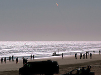Photo by Rick Wilson--1/16/03--Spectators watch from Sunsplash (CQ) Park in Daytona Beach Thursday morning January 16, 2003 as the Space Shuttle Columbia rockets into space after lifting off from Kennedy Space Center at Cape Canaveral..