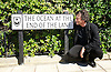 Neil Gaiman <br /> author<br /> of &quot;The Ocean At The End of the Lane&quot;<br /> has a road named after his book in Southsea, Portsmouth, Hampshire, Great Britain. <br /> 18th August 2013 <br /> <br /> <br /> Neil Gaiman <br /> <br /> with Cllr. Lynne Stagg Lord Mayor of Portsmouth <br /> <br /> and with <br /> <br /> Sam Cox - the Portsmouth Poet Laureate<br /> <br /> and later interviewed on stage at Guildhall Portsmouth by Dom Kippin and a Dalek!<br /> <br /> <br /> <br /> <br /> Photograph by Elliott Franks