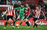 Preston's Callum Robinson surrounded by Brentford's Josh McEachran, John Egan and Andreas Bjelland<br /> <br /> Photographer Jonathan Hobley/CameraSport<br /> <br /> The EFL Sky Bet Championship - Brentford v Preston North End - Saturday 10th February 2018 - Griffin Park - Brentford<br /> <br /> World Copyright &copy; 2018 CameraSport. All rights reserved. 43 Linden Ave. Countesthorpe. Leicester. England. LE8 5PG - Tel: +44 (0) 116 277 4147 - admin@camerasport.com - www.camerasport.com