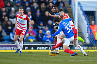 Ben Close of Portsmouth tackles Ben Whiteman of Doncaster Rovers during Portsmouth vs Doncaster Rovers, Sky Bet EFL League 1 Football at Fratton Park on 2nd February 2019
