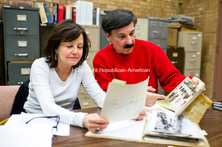 WATERBURY, CT--- -011416JS02--Kathy McNamara, left, and Michael Salvio, President, Historic Overlook Community Club, look over old photographs in the library of the Republican-American as they do research for an upcoming project. <br />  Jim Shannon Republican-American