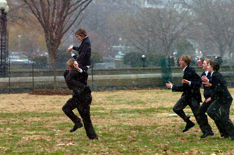 House pages,  Stasie Smith, 16, of California, and Andrew Breest, 16, of Georgia, left, are chased by their colleagues in a snowstorm, during their lunch break, on the West Front, Monday.