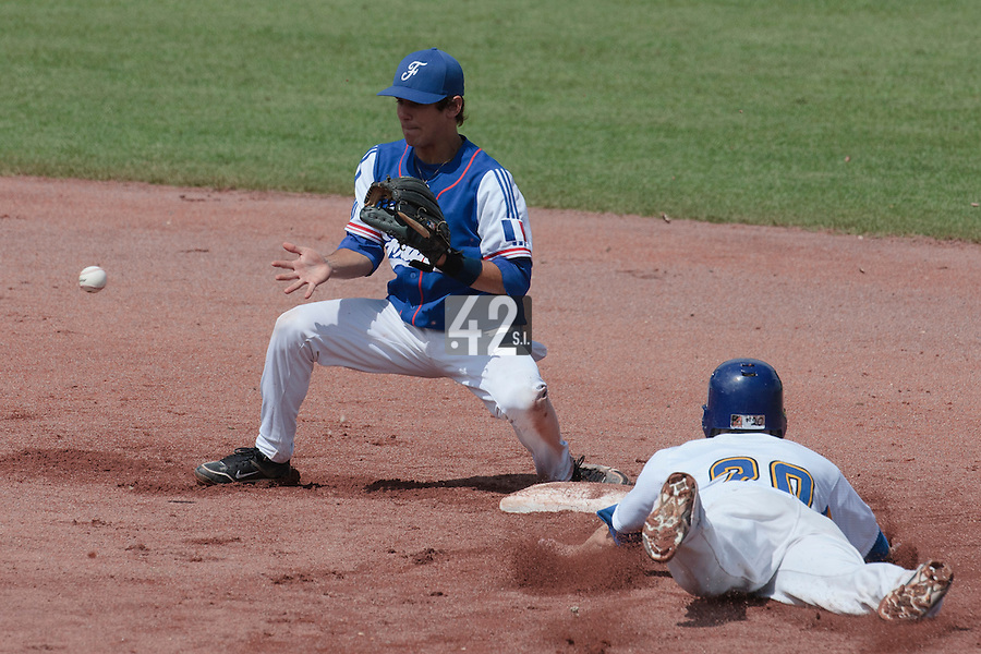30 july 2010: Maxime Lefevre of France eyes the ball as Christoffe Johansson of Sweden dives safely into second base during Sweden 3-3 win over France, in day 6 of the 2010 European Championship Seniors, at TV Cannstatt ballpark, in Stuttgart, Germany.
