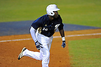 2 March 2012:  FIU outfielder Jabari Henry (14) runs to first as the FIU Golden Panthers defeated the Brown University Bears, 6-5, at University Park Stadium in Miami, Florida.