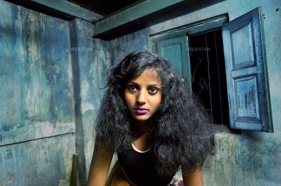 India. Calcutta. 2005. Portrait of Sumi a Hindu prostitute from the lower class. ..Inde. Calcutta. 2005. Portrait de Sumi a prostituée hindou de basse classe.